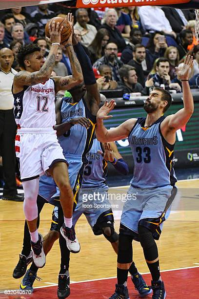 Washington Wizards forward Kelly Oubre Jr scores and is fouled by Memphis Grizzlies guard Andrew Harrison in the first half on January 18 at the...