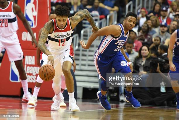 Washington Wizards forward Kelly Oubre Jr steals the ball from Philadelphia 76ers guard Markelle Fultz at Capital One Center