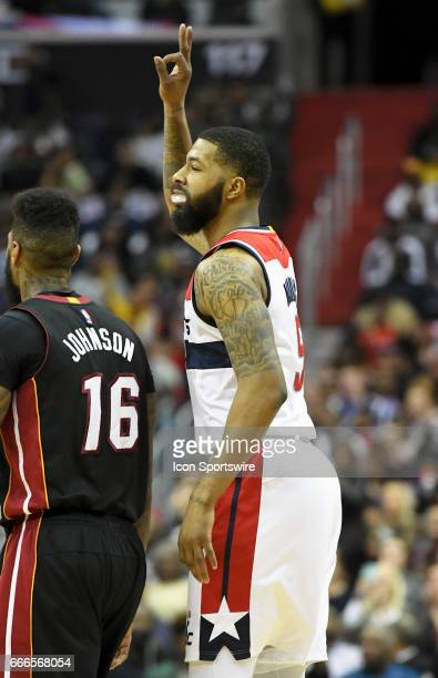 Washington Wizards forward Markieff Morris reacts after making a three point shot against the Miami Heat in the second half on April 8 at the Verizon...