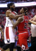 Washington Wizards forward Nene Hilario and Chicago Bulls guard Jimmy Butler get into an altercation during the second half of their first round...