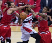 Washington Wizards forward Nene Hilario is swarmed by Chicago Bulls center Joakim Noah left and guard Jimmy Butler during the first half of their...