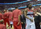Washington Wizards forward Nene Hilario leaves the court after he was ejected after receiving a double technical during a scuffle with Chicago Bulls...