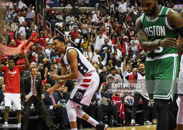 Washington Wizards forward Otto Porter Jr celebrates after a basket by Washington Wizards guard Bradley Beal during the second half of Game Four of...