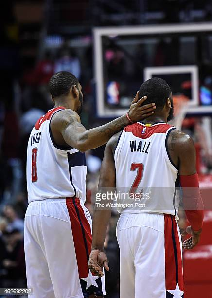 Washington Wizards forward Rasual Butler consoles Washington Wizards guard John Wall after Wall missed a shot with just over fifteen seconds left...
