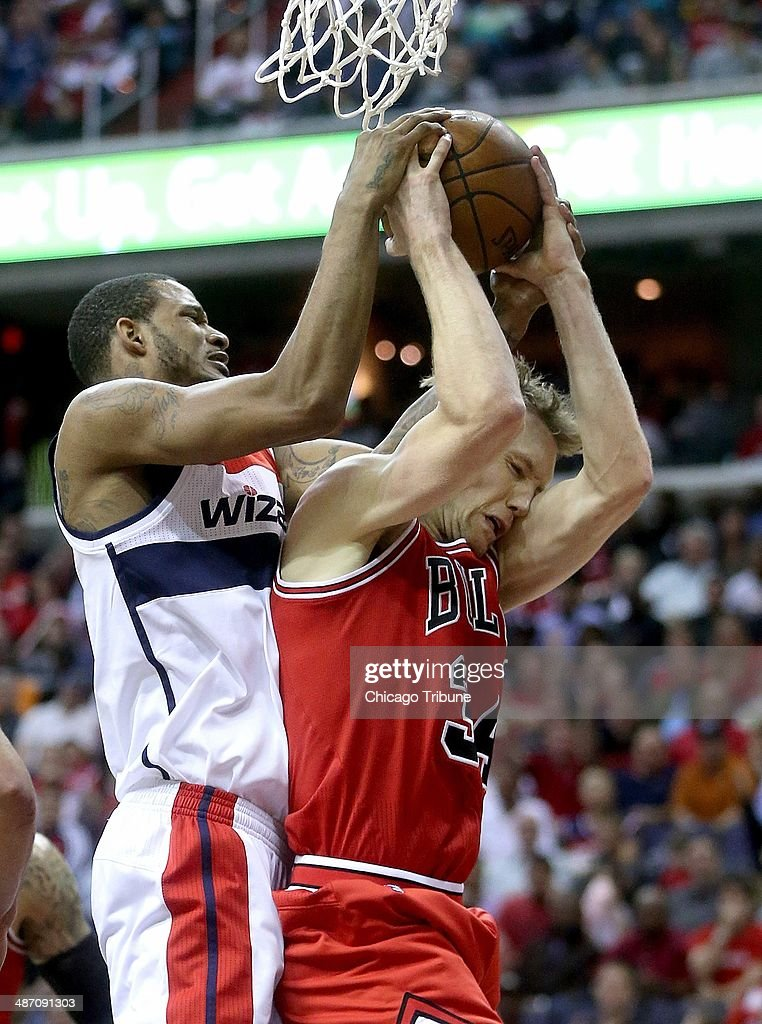 Washington Wizards forward Trevor Ariza (1) and Chicago Bulls forward Mike Dunleavy (34) battle for a rebound during the second half of their first round playoff game played at the Verizon Center in Washington, Sunday, Apr. 27, 2014.