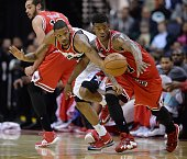 Washington Wizards forward Trevor Ariza left tips the ball away from Chicago Bulls guard Jimmy Butler in the third quarter at the Verizon Center in...