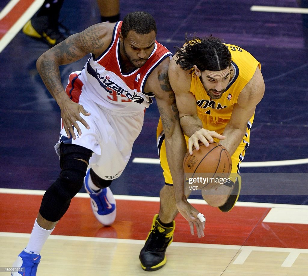 Washington Wizards forward Trevor Booker (35) and Indiana Pacers forward Luis Scola (4) go after a loose ball in the fourth quarter of Game 3 of the NBA Eastern Conference semifinals at the Verizon Center in Washington, D.C., Friday, May 9, 2014. The Pacers defeated the Wizards, 85-63.