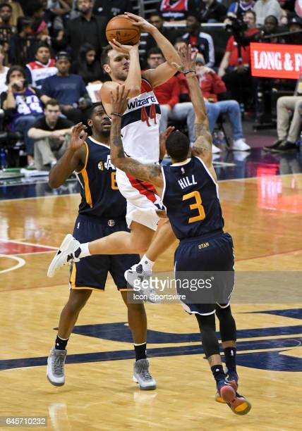 Washington Wizards guard Bojan Bogdanovic makes a long three point basket in the second half against Utah Jazz guard George Hill on February 26 at...
