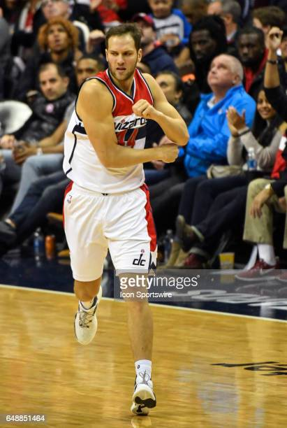 Washington Wizards guard Bojan Bogdanovic reacts after making a three point basket in the second half against the Orlando Magic on March 5 at the...
