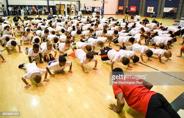 Washington Wizards guard Bradley Beal does push ups with campers at the start of his basketball ProCamp in Lorton VA