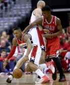 Washington Wizards guard Bradley Beal gets away from the pressure by Chicago Bulls guard Jimmy Butler on a pick by Wizards center Marcin Gortat...