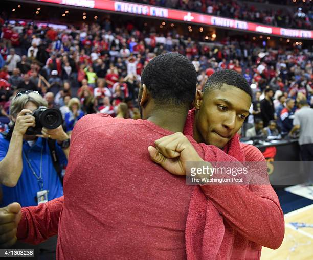 Washington Wizards guard Bradley Beal hugs John Wall after their win over the Toronto Raptors during game four action on April 26 2015 in Washington...