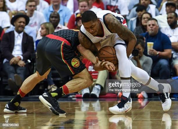 WASHINGTON DC APRIL Washington Wizards guard Bradley Beal is fouled by Atlanta Hawks guard Jose Calderon as he tries to maintain control of the ball...