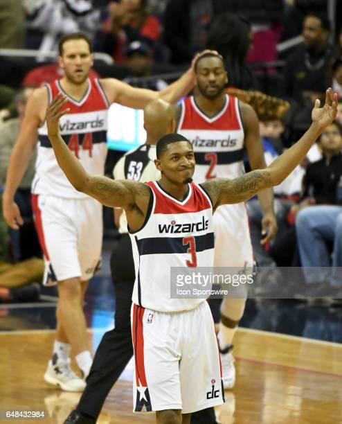 Washington Wizards guard Bradley Beal raises his arms followed by guard Bojan Bogdanovic and guard John Wall after making a three point basket...