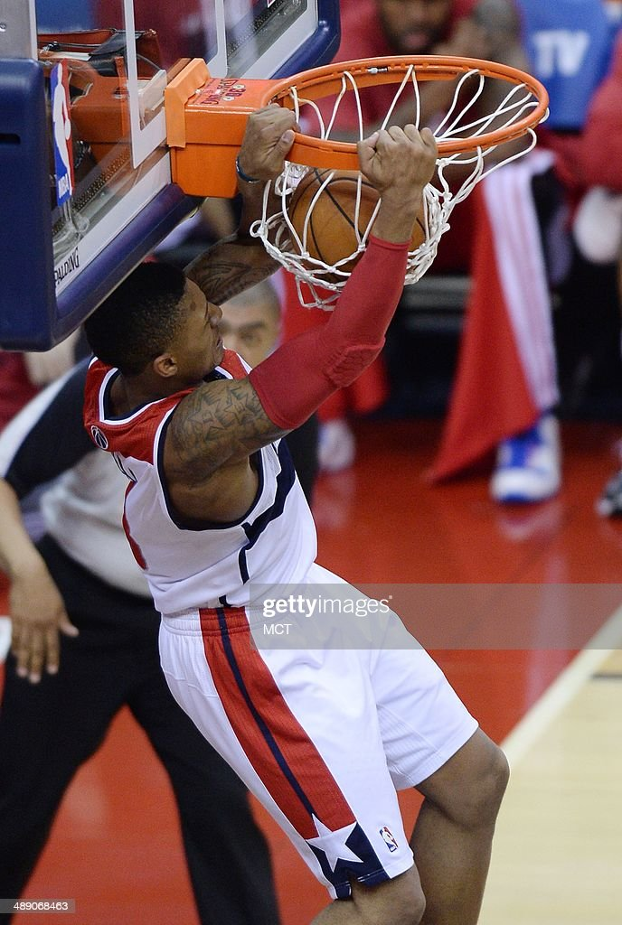 Washington Wizards guard Bradley Beal (3) scores on a lob pass from teammate John Wall during the third quarter against the Indiana Pacers in Game 3 of the NBA Eastern Conference semifinals at the Verizon Center in Washington, D.C., Friday, May 9, 2014. The Pacers defeated the Wizards, 85-63.
