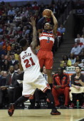 Washington Wizards guard Bradley Beal shoots over Chicago Bulls guard Jimmy Butler during the second half of game five of the NBA playoffs between...