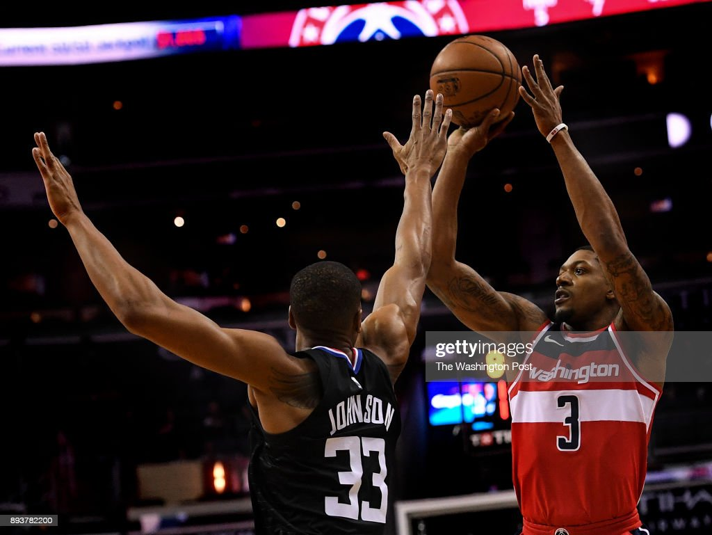 Washington Wizards guard Bradley Beal (3) shoots over Los Angeles Clippers forward Wesley Johnson (33) during the first half of the game between the Washington Wizards and the LA Clippers at Capital One Arena on Friday, December 15, 2017.