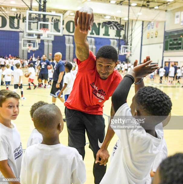 Washington Wizards guard Bradley Beal shows his campers how to hold their follow through during his basketball ProCamp in Lorton VA