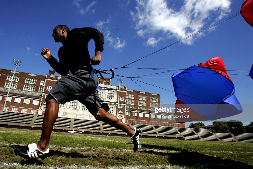 Washington Wizards Guard Gilbert Arenas does sprints pulling a parachute on the football field at Cardozo High School as works to come back from a...