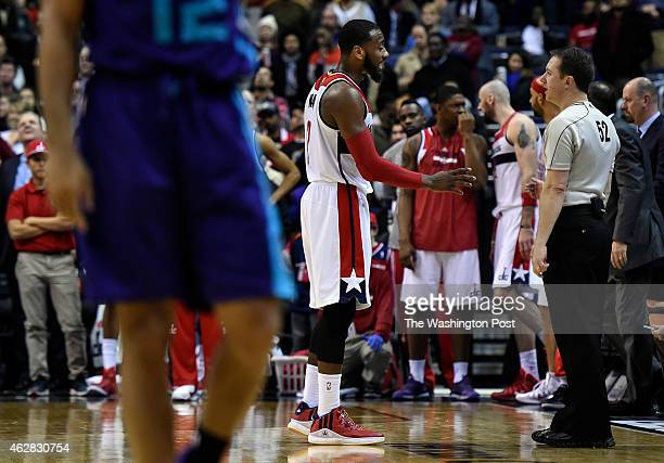 Washington Wizards guard John Wall discusses a foul call with referee Scott Twardoski during the second half of the game between the Washington...