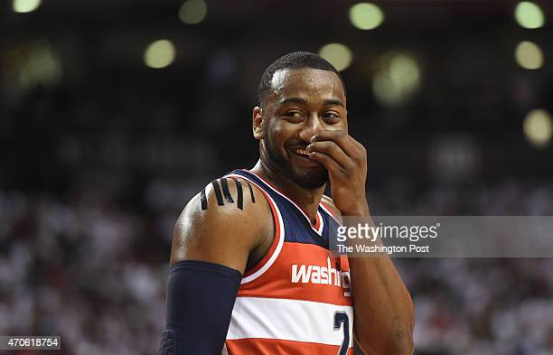 Washington Wizards guard John Wall does a little talking to the Toronto Raptors fans during game two action on April 21 2015 in Toronto Ontario