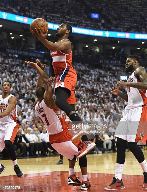 Washington Wizards guard John Wall drives to the basket against Toronto Raptors guard Kyle Lowry during game one action on April 18 2015 in Toronto...