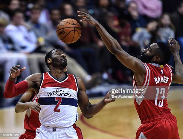 Washington Wizards guard John Wall has a pass of his batted away by Houston Rockets guard James Harden during the second half of the game between the...