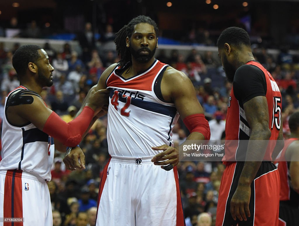 Washington Wizards guard <a gi-track='captionPersonalityLinkClicked' href=/galleries/search?phrase=John+Wall&family=editorial&specificpeople=2265812 ng-click='$event.stopPropagation()'>John Wall</a> (2) holds back Washington Wizards forward <a gi-track='captionPersonalityLinkClicked' href=/galleries/search?phrase=Nene+Hilario+-+Basketball+Player&family=editorial&specificpeople=4250456 ng-click='$event.stopPropagation()'>Nene Hilario</a> (42) in the first quarter against the Toronto Raptors during game four action on April 26, 2015 in Washington, DC.