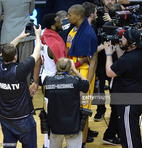 Washington Wizards guard John Wall left and Indiana Pacers forward David West talk following Game 6 of the NBA Eastern Conference semifinals playoff...