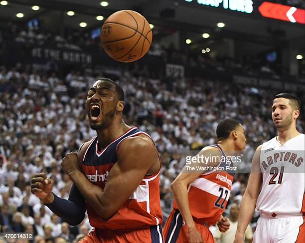 Washington Wizards guard John Wall reacts after dunking against the Toronto Raptors during game two action on April 21 2015 in Toronto Ontario