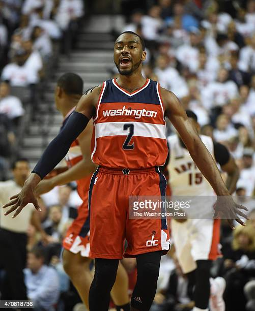 Washington Wizards guard John Wall reacts after sinking a third period basket against the Toronto Raptors during game two action on April 21 2015 in...