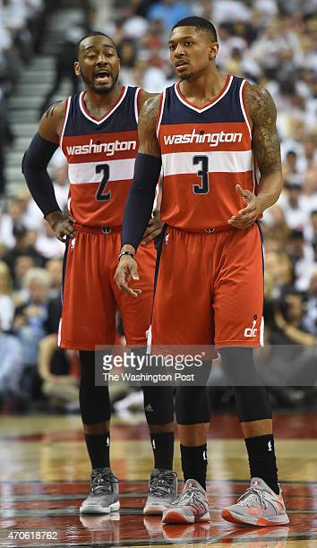 Washington Wizards guard John Wall talks with Bradley Beal during game two action on April 21 2015 in Toronto Ontario