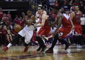 Washington Wizards guard John Wall tries to work his way past Chicago Bulls guard Kirk Hinrich and Chicago Bulls guard Jimmy Butler during the fourth...