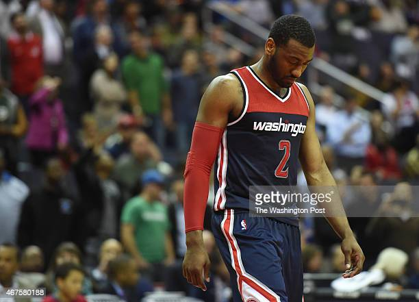 Washington Wizards guard John Wall walks onto the court during their 103101 loss to the Indiana Pacers on March 25 2015 in Washington DC