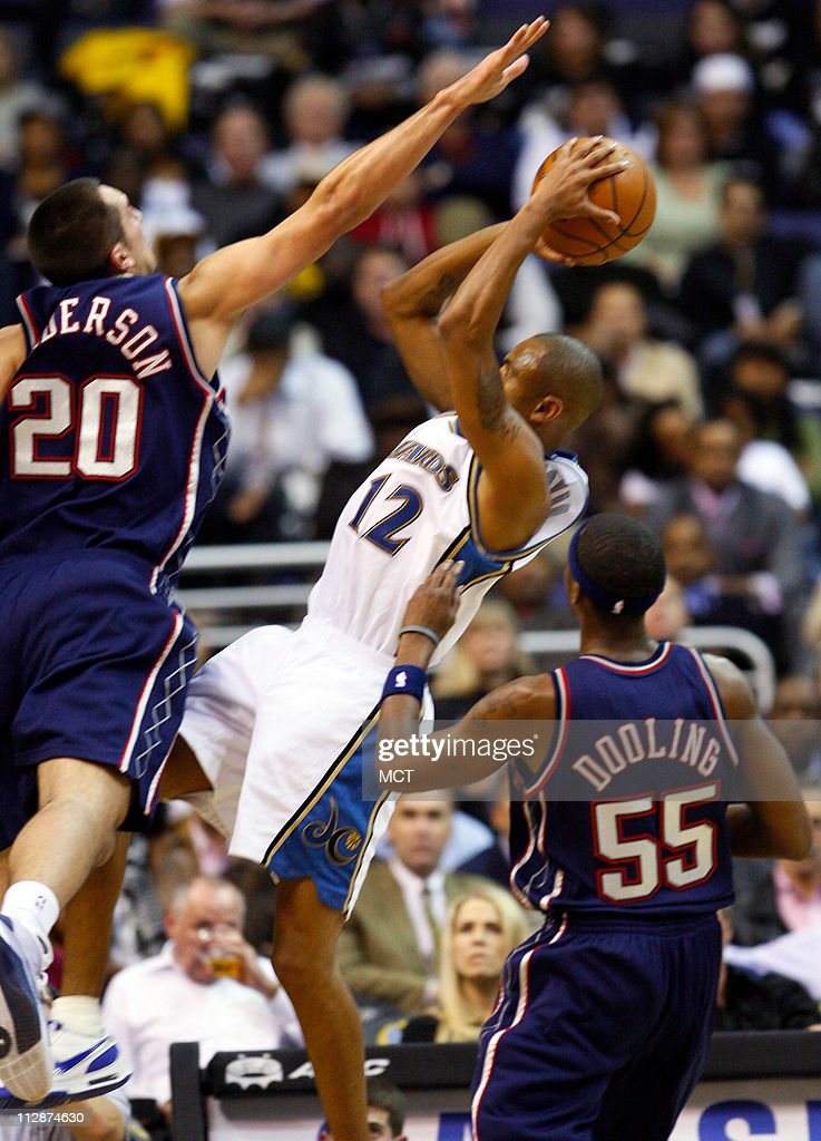 Washington Wizards guard Juan Dixon puts up a tough shot over the New Jersey Nets' Ryan Anderson (20) during opening night action at the Verizon Center in Washington, D.C., Wednesday, October 29, 2008.