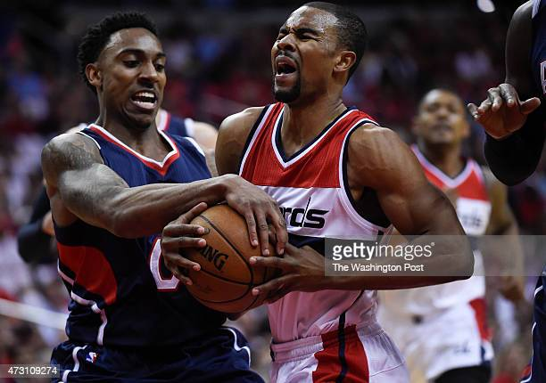 Washington Wizards guard Ramon Sessions is fouled by Atlanta Hawks guard Jeff Teague during the first half of Game 4 of the Eastern Conference...