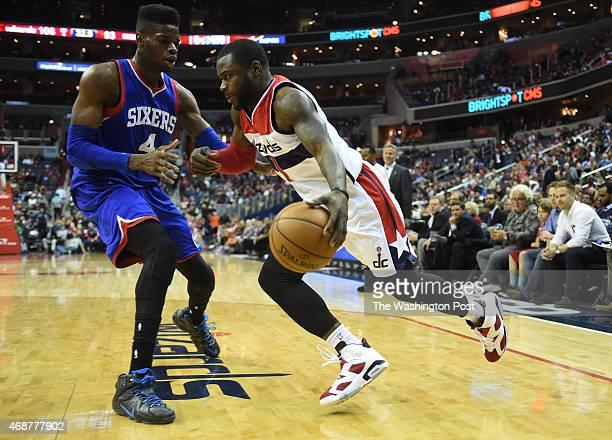 Washington Wizards guard Will Bynum drives baseline on Philadelphia 76ers center Nerlens Noel on April 1 2015 in Washington DC