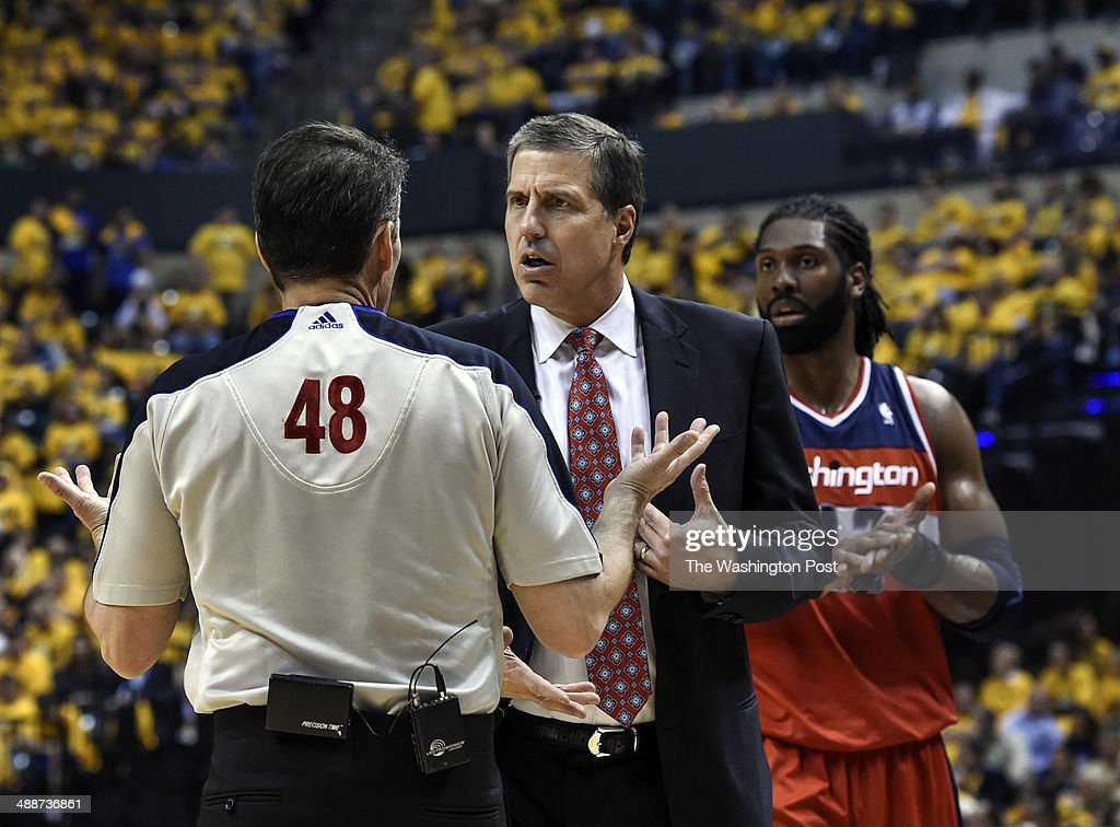 Washington Wizards head coach Randy Wittman talks with referee Scott Foster about a foul call during the first half of the first game of the Eastern...