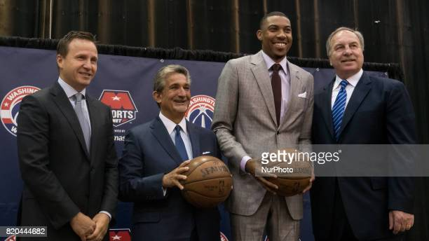 Washington Wizards head coach Scott Brooks owner Ted Leonsis player Otto Porter and President Ernie Grunfeld pose for a photo after their press...