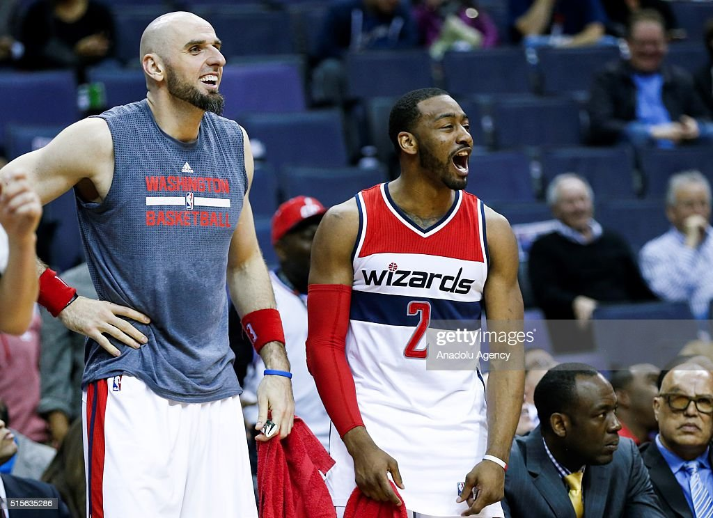 Washington Wizards John Wall (2) and Marcin Gortat (L) react to a dunk by Kelly Oubre (not seen) at the Verizon Center in Washington, USA on March 14, 2016. The Wizards dominated the Pistons, 124-81.