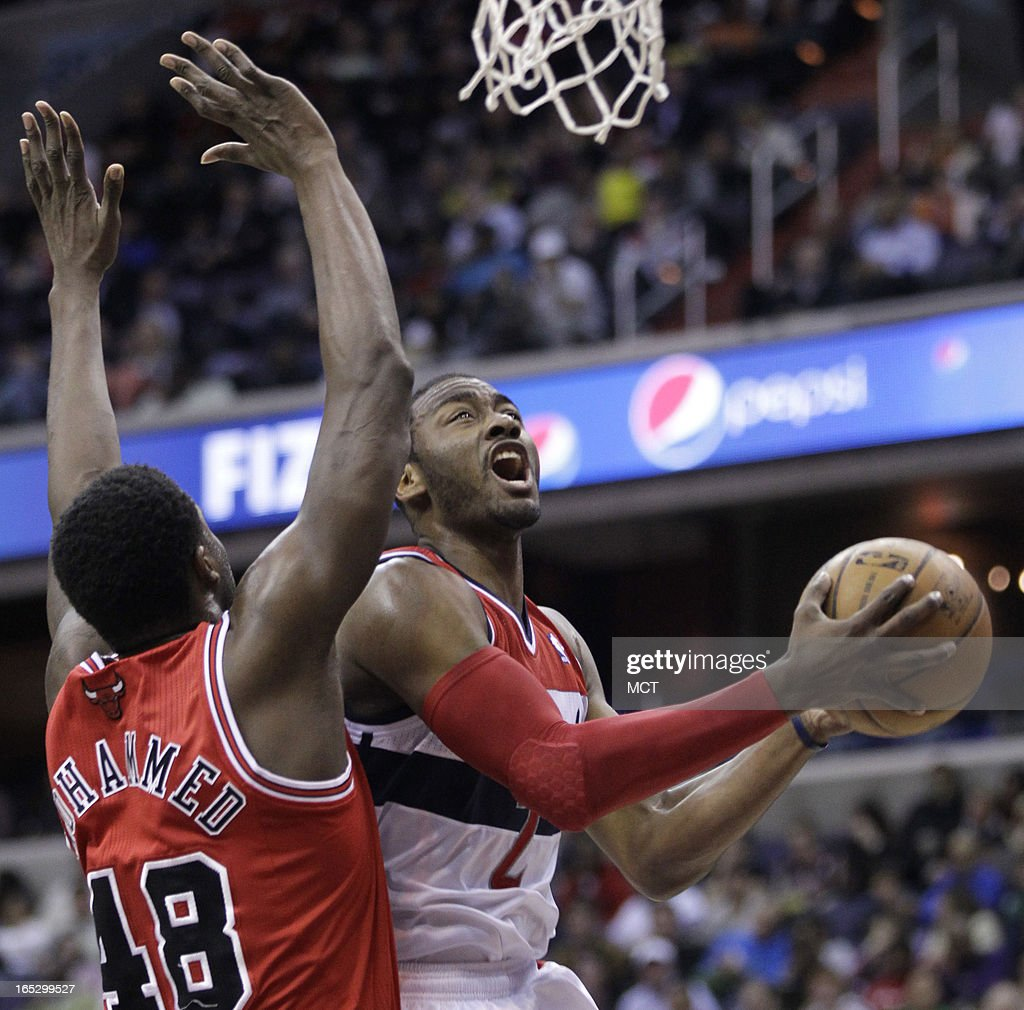 Washington Wizards' John Wall, right, is fouled by Chicago Bulls' Nazr Mohammed (48) as he shoots the ball in the second half at the Verizon Center in Washington, D.C., Tuesday, April 2, 2013.