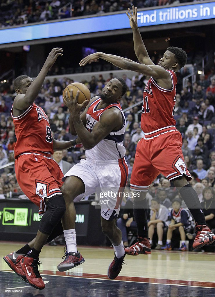 Washington Wizards' Martell Webster, center, is fouled by Chicago Bulls' Jimmy Butler (21) as Chicago Bulls' Luol Deng (9) defends in the second half at the Verizon Center in Washington, D.C., Tuesday, April 2, 2013.