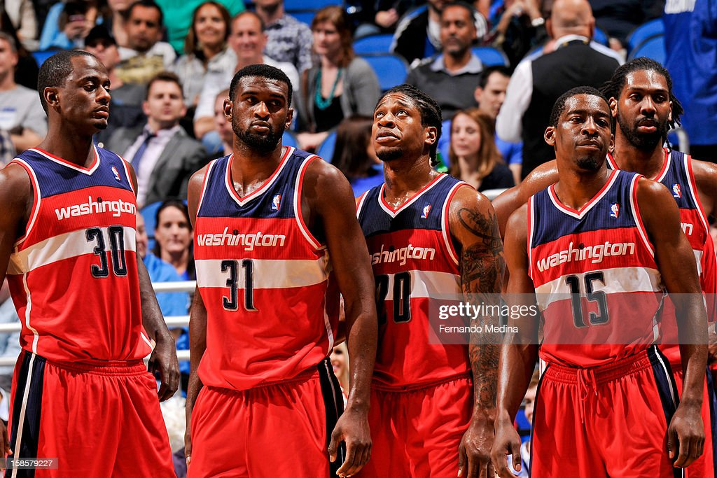 Washington Wizards players, from left, Earl Barron #30, Chris Singleton #31, Cartier Martin #20, Jordan Crawford #15 and Nene #42 waits to resume action against the Orlando Magic on December 19, 2012 at Amway Center in Orlando, Florida.
