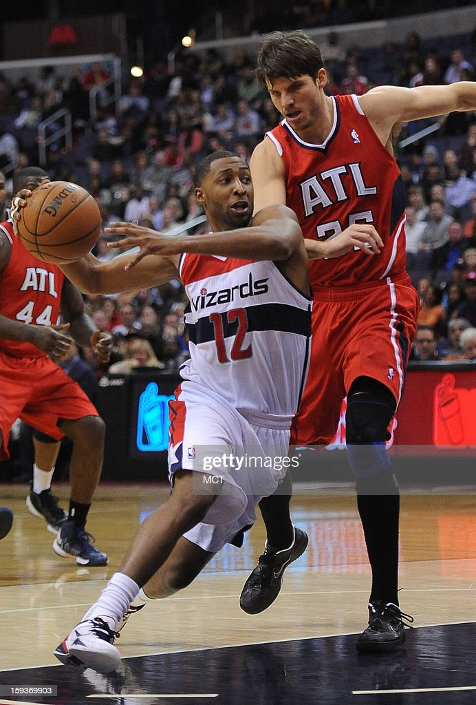 Washington Wizards point guard A.J. Price (12) drives the lane against Atlanta Hawks center Zaza Pachulia (27) in the fourth quarter at the Verizon Center in Washington, D.C., Saturday, January 12, 2013. The Wizards defeated the Hawks, 93-83.