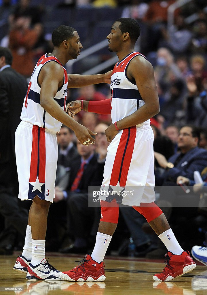 Washington Wizards point guard A.J. Price (12), left, greets Wizards point guard John Wall (2), as Wall comes into the game against the Atlanta Hawks, and replaces him in the first quarter at the Verizon Center in Washington, D.C., Saturday, January 12, 2013.