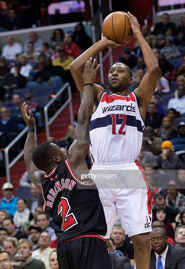 Washington Wizards point guard A.J. Price (12) shoots over Chicago Bulls point guard Nate Robinson (2) during the second half of their game played at the Verizon Center in Washington, D.C., Saturday, January 26, 2013. Washington defeated Chicago 86-73.