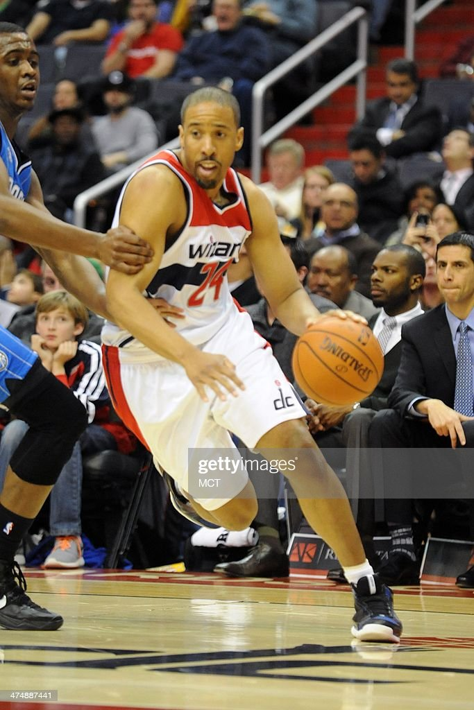 Washington Wizards point guard Andre Miller (24) dribbles to the basket during the second half against the Orlando Magic at the Verizon Center in Washington, D.C., Tuesday, February. 25, 2014. Washington won, 115-106.