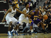 Washington Wizards point guard Gilbert Arenas and Washington Wizards shooting guard Nick Young try to shut down Los Angeles Lakers shooting guard...