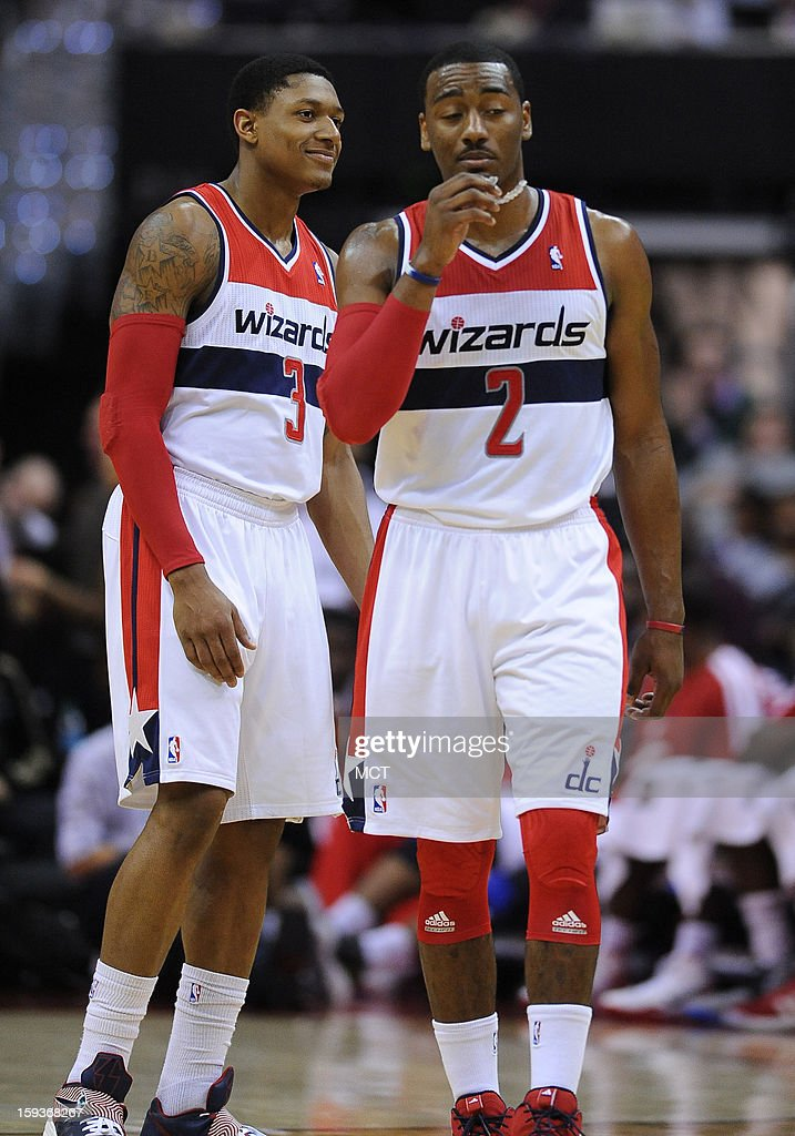 Washington Wizards point guard John Wall (2) and Wizards shooting guard Bradley Beal (3) wait for play to resume against the Atlanta Hawks in the third quarter at the Verizon Center in Washington, D.C., Saturday, January 12, 2013. The Wizards defeated the Hawks, 93-83.