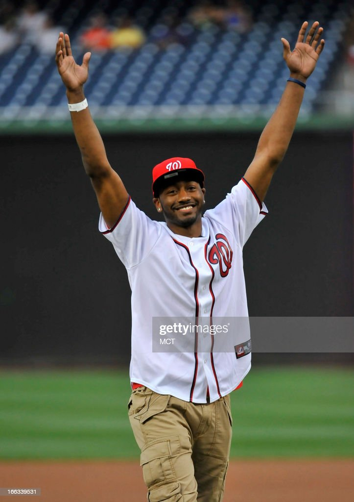 Washington Wizards point guard John Wall celebrates throwing out the first pitch for the Washington Nationals vs. Chicago White SoxÕs baseball game at Nationals Park in Washington, D.C., Thursday, April 11, 2013.